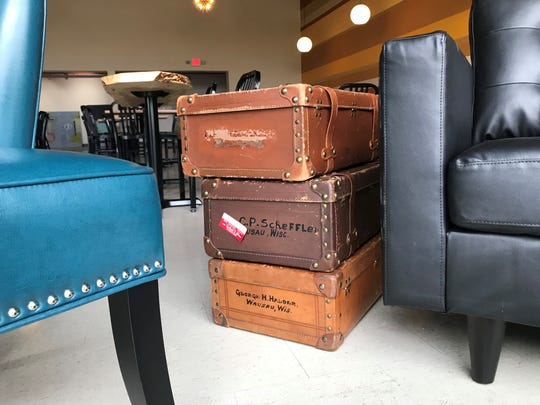 Suitcases provide a touch of history and decor at Whitewater Music Hall. They were left behind from when the building was formerly the city's Masonic Lodge.