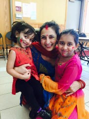 Face painting, colorful clothing and fun are all part of Holi, a playful festival that celebrates the coming of spring. Siya Patel, Dr. Swati Biswas and Diya Patel were all smiles at a past Holi festival.