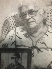 Regina Sudut holds a picture of her son, Jerome, in a photo that ran in the Wausau Daily Herald in 1985.