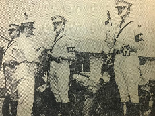 Prior to serving in Korea, Jerome Sudut, at right, was a military police officer.