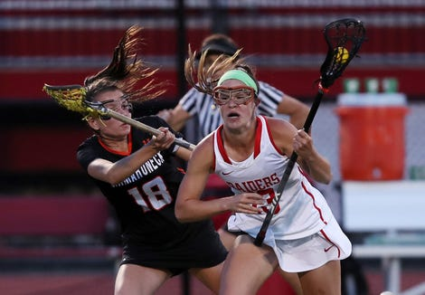 North Rockland's Kerri Gutenberger (13) drives around Mamaroneck's Brigid Knowles (18) during the girls lacrosse championship game at Fox Lane High School in Bedford May 22, 2019. North Rockland won the game 9-8.