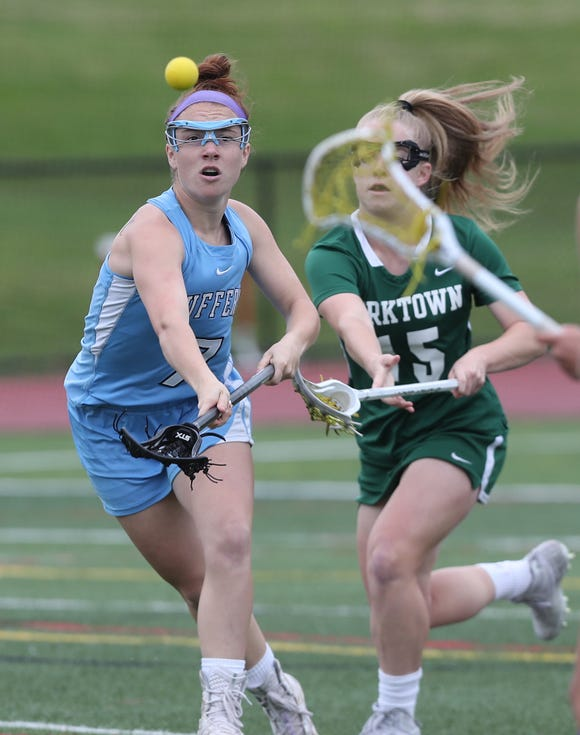 From left, Suffern's Samantha Schelling (7) and Yorktown's Kelsey McDonnell (15) battle for a loose ball during the Section 1 girls lacrosse championship game at Fox Lane High School in Bedford May 23, 2019.