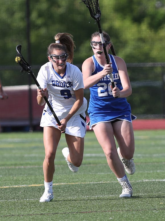 Caroline Ircha (9), shown in action against North Salem in the Section 1 Class D championship game, was one of 12 Broncos to score as Bronxville routed Johnstown to advance to the Class D State Semifinals.