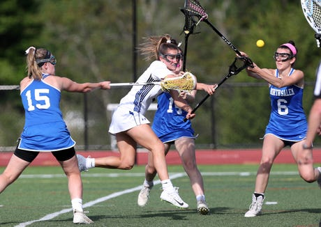 Bronxville's Caroline Ircha (9), shown here in a earlier game against North Salem, finished with two goals and one assist Saturday in a state championship game loss to Mattituck/Southold.
