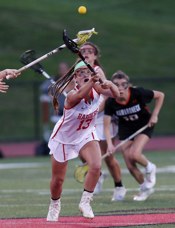 North Rockland's Kerri Gutenberger (13) controls a loose ball against Mamaroneck during the girls lacrosse championship game at Fox Lane High School in Bedford May 22, 2019. North Rockland won the game 9-8.