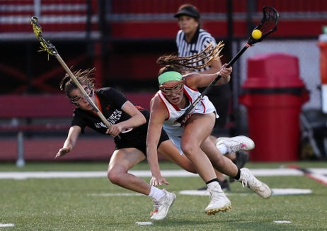 North Rockland's Kerri Gutenberger (13) tries to get around Mamaroneck's Brigid Knowles (18) during the girls lacrosse championship game at Fox Lane High School in Bedford May 22, 2019. North Rockland won the game 9-8.