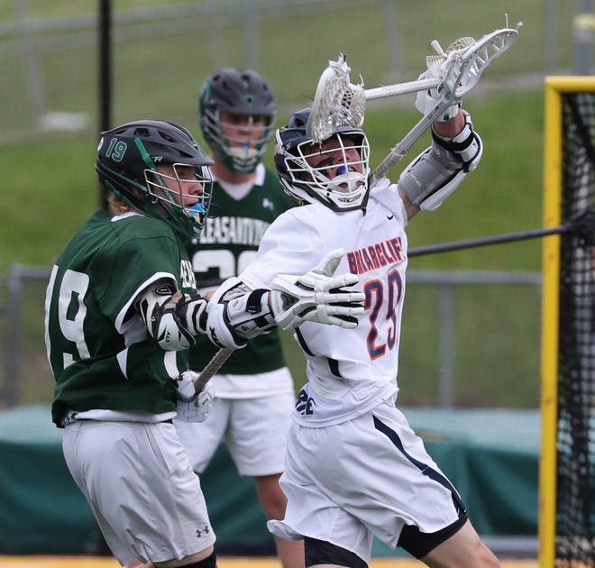 Pleasantville's Brennan McDermott, left, pressures, Briarcliff's Matthew Waterhouse during the Class D lacrosse final at Lakeland May 23, 2019. 9 24