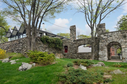 In Tuxedo Park, an international-style glass house was built amid the ruins of a 1903 GIlded Age mansion that burned in an arson fire.