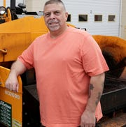 Frank DiZenzo, Clarkstown's superintendent of highways, stand next to an asphalt paver at the highway department in Clarkstown on Apr. 17, 2017.