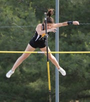"Padua's Erin Kelleher clears the bar on her way to winning the girls pole vault with a 11' 9"" vault during the Rod Lambert Meet of Champions at Caravel Academy in May."