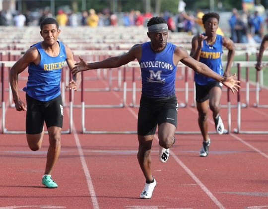 Middletown's Brahmir Vick sets a state record in the 110 meter hurdles with a time of 14 seconds during the Rod Lambert Meet of Champions at Caravel Academy Wednesday. Caesar Rodney's Leon Jett (left) was second.