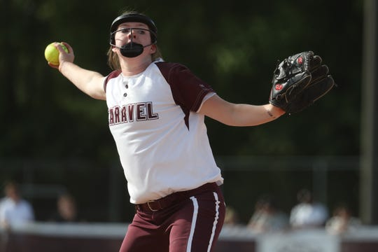 Caravel Academy's Savannah Sheats (14) pitches Wednesday afternoon against Charter School of Wilmington in the DIAA High School Softball semifinals. Caravel defeated Charter 8-0.