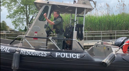 Delaware Division of Fish and Wildlife Natural Resources Police Officer 1st Class Thomas Ritterhoff puts in for patrol on the Delaware River Thursday.