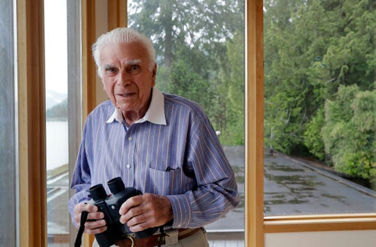 In this photo taken Monday, May 20, 2019, D-Day veteran Norman Harold Kirby poses for a photo at his home in Lions Bay, Canada. The Canadian from British Columbia had joined the army when he was only 17 and was barely a 19-year-old private when he climbed into the landing craft that would take him to shore on June 6, 1944. (AP Photo/Elaine Thompson)