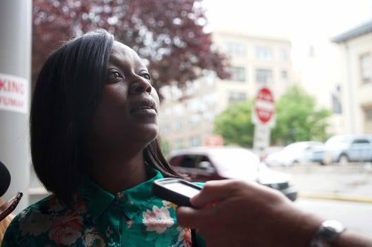 Lillian Oliver, partner to Roman Shankaras, speaks to the media after a jury found Shankaras not guilty of murder and all other charges after a trial that accused him of planning and orchestrating the 2017 fatal uprising at Delaware's largest prison.