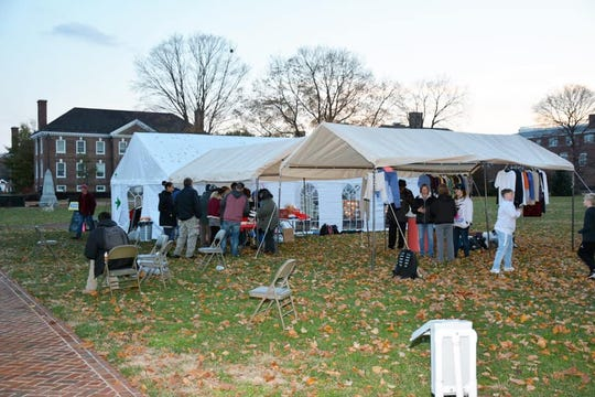 The International House of Prayer-First State Forerunner Fellowship Church in Dover holds services in a tent on Legislative Mall at the end of each month. People who are homeless, such as Dennis Christensen, sometimes attend.