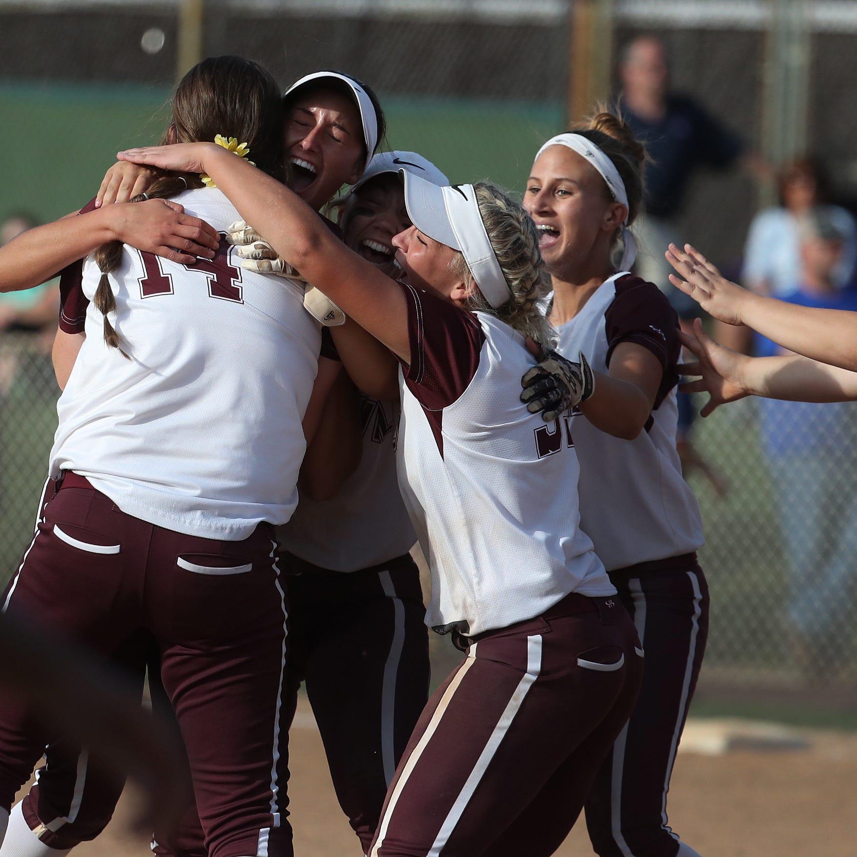 The Caravel Academy softball team celebrate an...