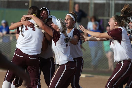 The Caravel Academy softball team celebrates an 8-0 win over Charter School of Wilmington in the DIAA Softball Tournament semifinals.