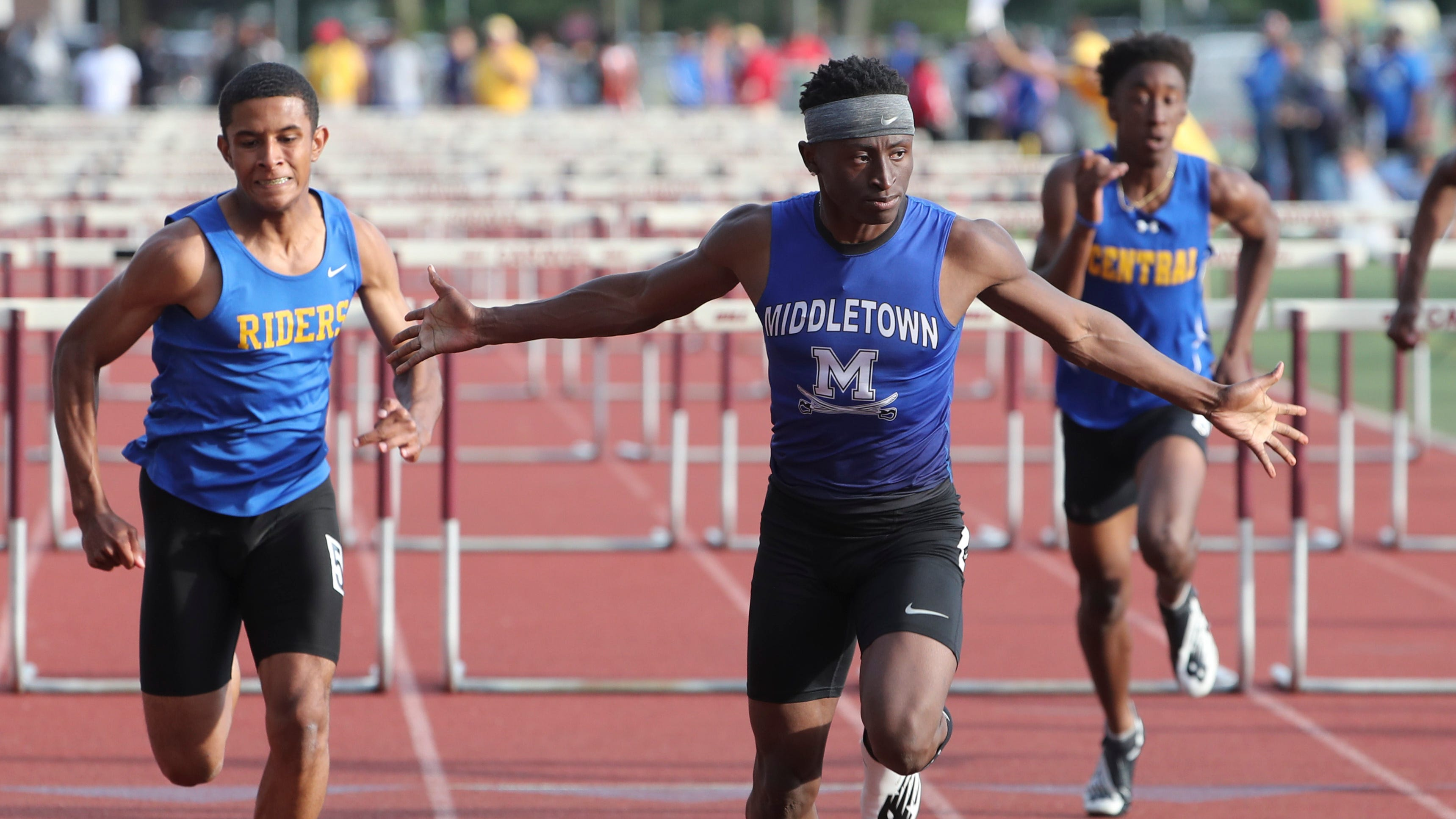 Middletown's Brahmir Vick sets a state record in the 110 meter hurdles with a time of 14.00 seconds during the Rod Lambert Meet of Champions at Caravel Academy Wednesday. Caesar Rodney's Leon Jett (left) was second.