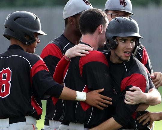 William Penn's Hank Wilkerson (right) is congratulated after the Colonials scored two runs in the seventh to edge Brandywine 3-2 at home Thursday in the DIAA Baseball Tournament. Wilkerson tied the game with an RBI double, and Dylan Grygo won it with a sacrifice fly that scored Matt Hammond.