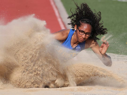 Destiny Bailey-Perkins of Caesar Rodney lands a long jump on her way to winning the event (along with the triple jump and 100 meter dash) during the Rod Lambert Meet of Champions at Caravel Academy Wednesday.