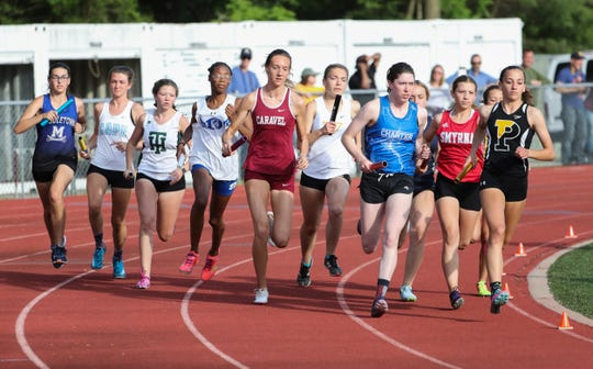 The field in the girls 4x800 meter relay is grouped together at the start as Padua's Elena Bocchetti (right) runs the first leg for the Pandas on the way to a first place during the Rod Lambert Meet of Champions at Caravel Academy Wednesday.