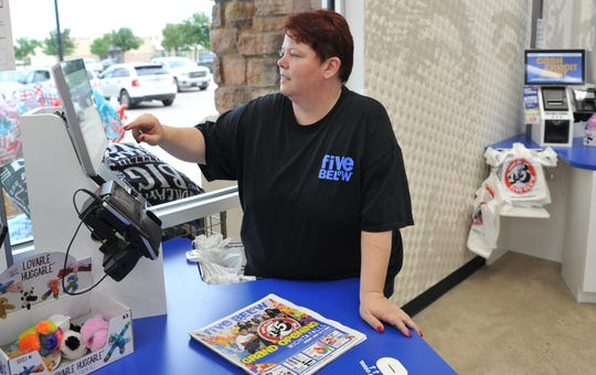 Five Below store manager Stacey Russell prepares for the store's new Wichita Falls location in the Quail Creek Crossing located on Lawrence Road. The grand opening is Friday.