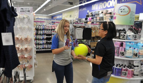 Five Below Wow crew members Kylea Borgaman, left, and Jeanie Evans stock merchandise in preparation for the store's new Wichita Falls location in the Quail Creek Crossing on Lawrence Road.