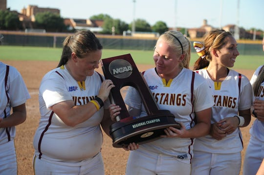 Alyson Deatherage (left) and Mallory Mooney hold the NCAA II South Central Regional championship trophy in 2011. Deatherage and Mooney now coach against each other in one of the area's biggest rivalry.