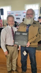 David Graham (left), NRA Field Representative for Southern Ohio, recently presented Don Pagath with a plaque and a coat as he was recognized as the Southern Ohio Volunteer of the Year.