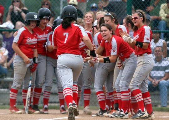 The Generals greet Karsyn Lentz after her home run against River View in the Division II regional semifinals Wednesday afternoon.