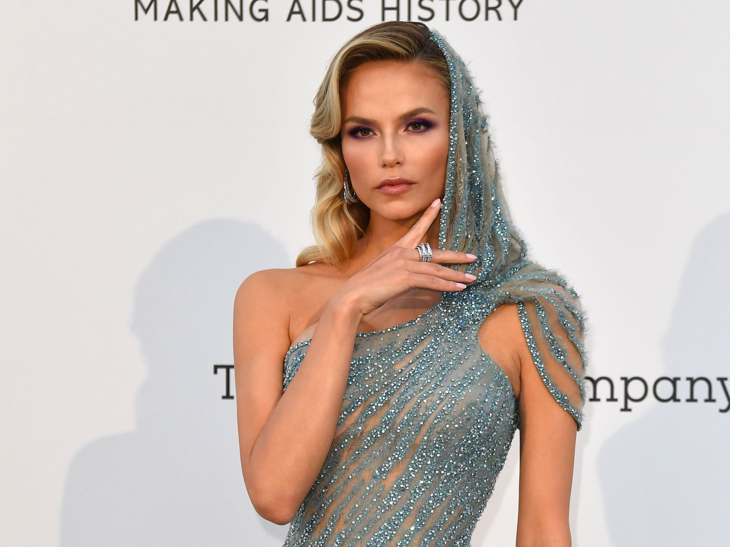 Russian model Natasha Poly poses as she arrives on May 23, 2019 for the amfAR 26th Annual Cinema Against AIDS gala at the Hotel du Cap-Eden-Roc in Cap d'Antibes, southern France, on the sidelines of the 72nd Cannes Film Festival. (Photo by Alberto PIZZOLI / AFP)ALBERTO PIZZOLI/AFP/Getty Images ORIG FILE ID: AFP_1GU1UG