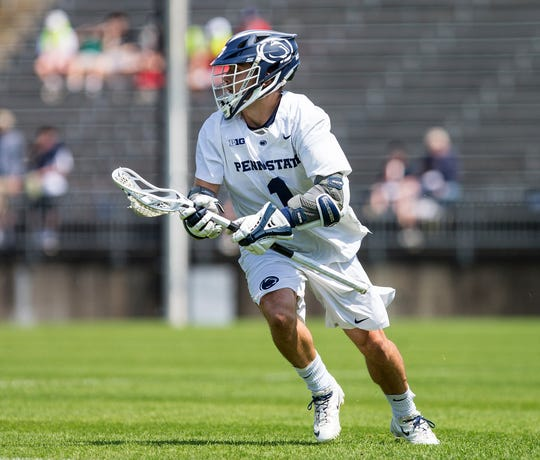 Penn State lacrosse player Grant Ament carries the ball during his team's NCAA tournament game against Loyola (Md.).
