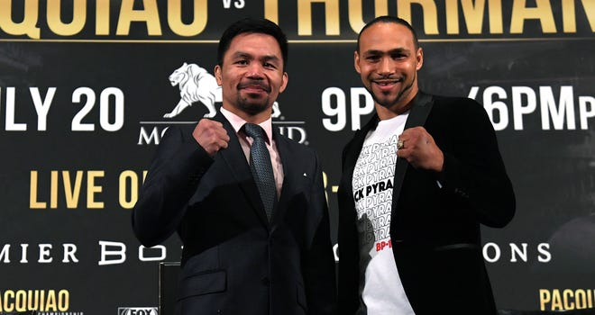Manny Pacquiao, left, and Keith Thurman are scheduled to fight on July 20.