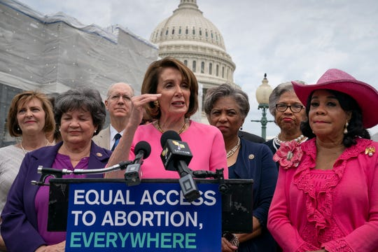 Speaker of the House Nancy Pelosi, D-Calif., center, flanked by Rep. Lois Frankel, D-Fla., left, and Rep. Frederica Wilson, D-Fla., right, joins members of the Democratic Women's Caucus and the Pro-Choice Caucus at a news conference on Roe vs. Wade and women's rights, at the Capitol in Washington, Thursday, May 23, 2019.