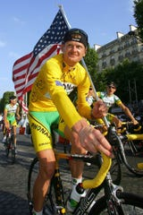 Floyd Landis celebrates his 2006 Tour de France win.