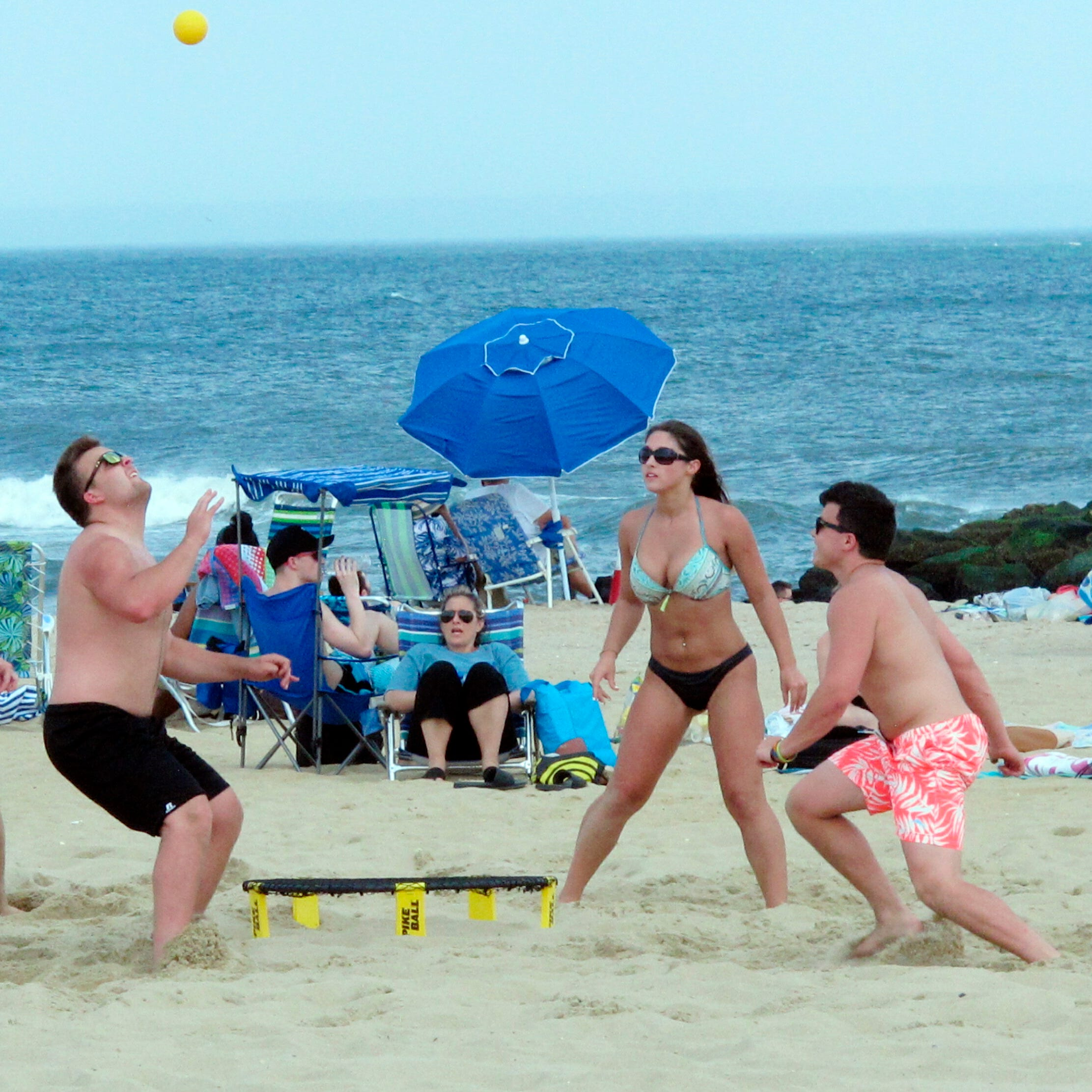 Beach lovers frolic in Belmar, New Jersey.