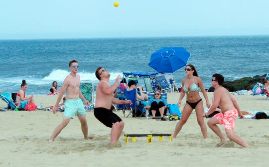 Beach lovers frolic in Belmar, New Jersey.