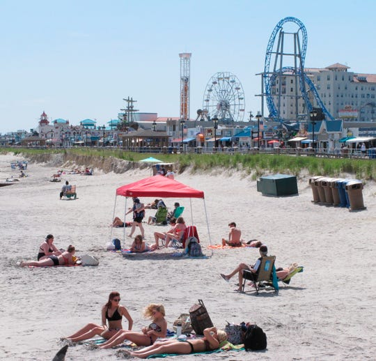 Beachgoers sun themselves in Ocean City, New Jersey.