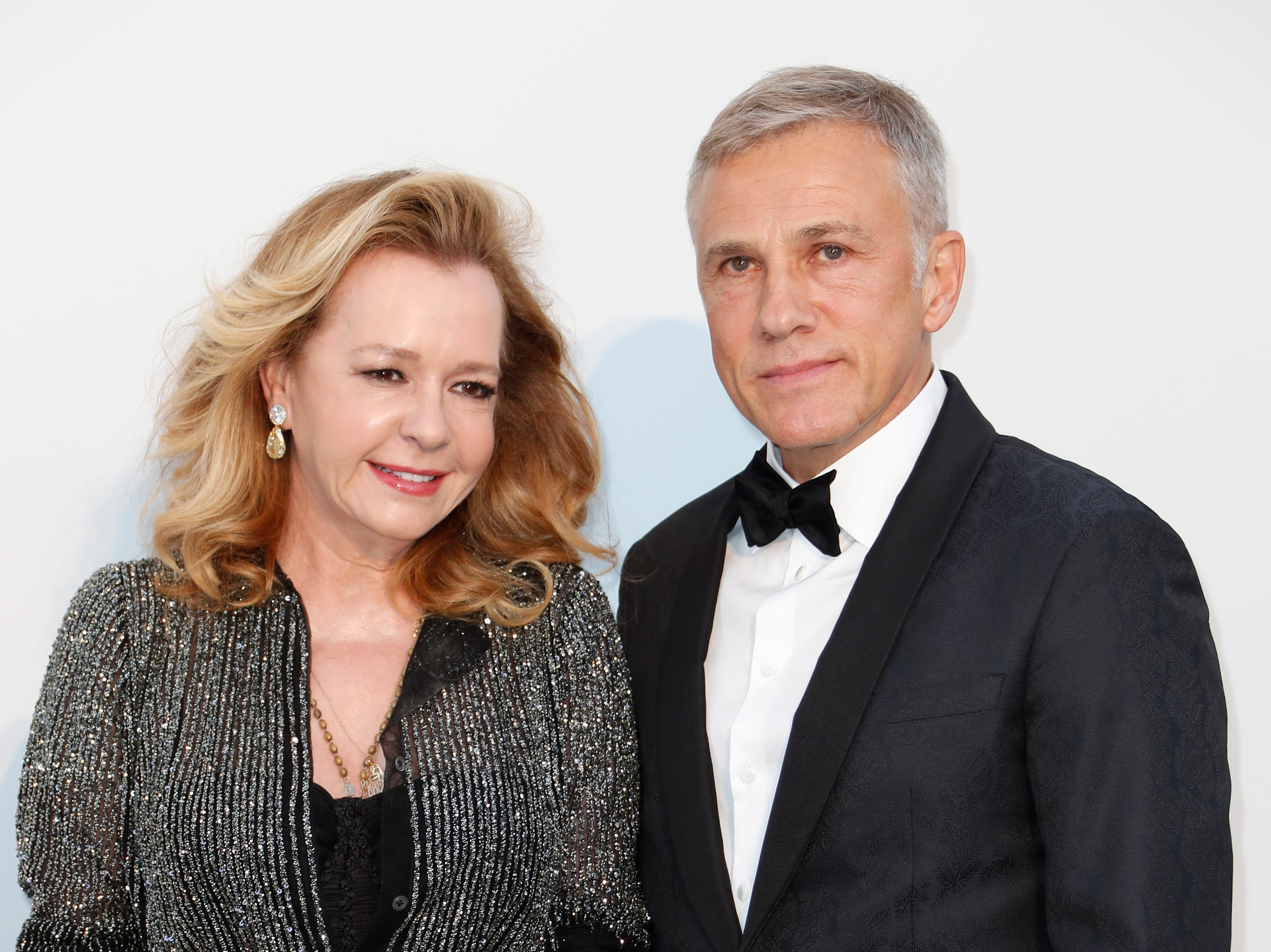 epa07595195 Austrian actor Christoph Waltz (R) and Caroline Scheufele (L) attends the Cinema Against AIDS amfAR gala 2019 held at the Hotel du Cap, Eden Roc in Cap d'Antibes, France, 23 May 2019, within the scope of the 72nd annual Cannes Film Festival that runs from 14 to 25 May.  EPA-EFE/SEBASTIEN NOGIER