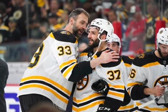 Bruins veterans Zdeno Chara (left) and Patrice Bergeron (right) won a Stanley Cup together in Boston in 2011.