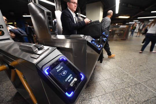 New York subway riders will be able to use phones and credit cards to pay the fare May 31