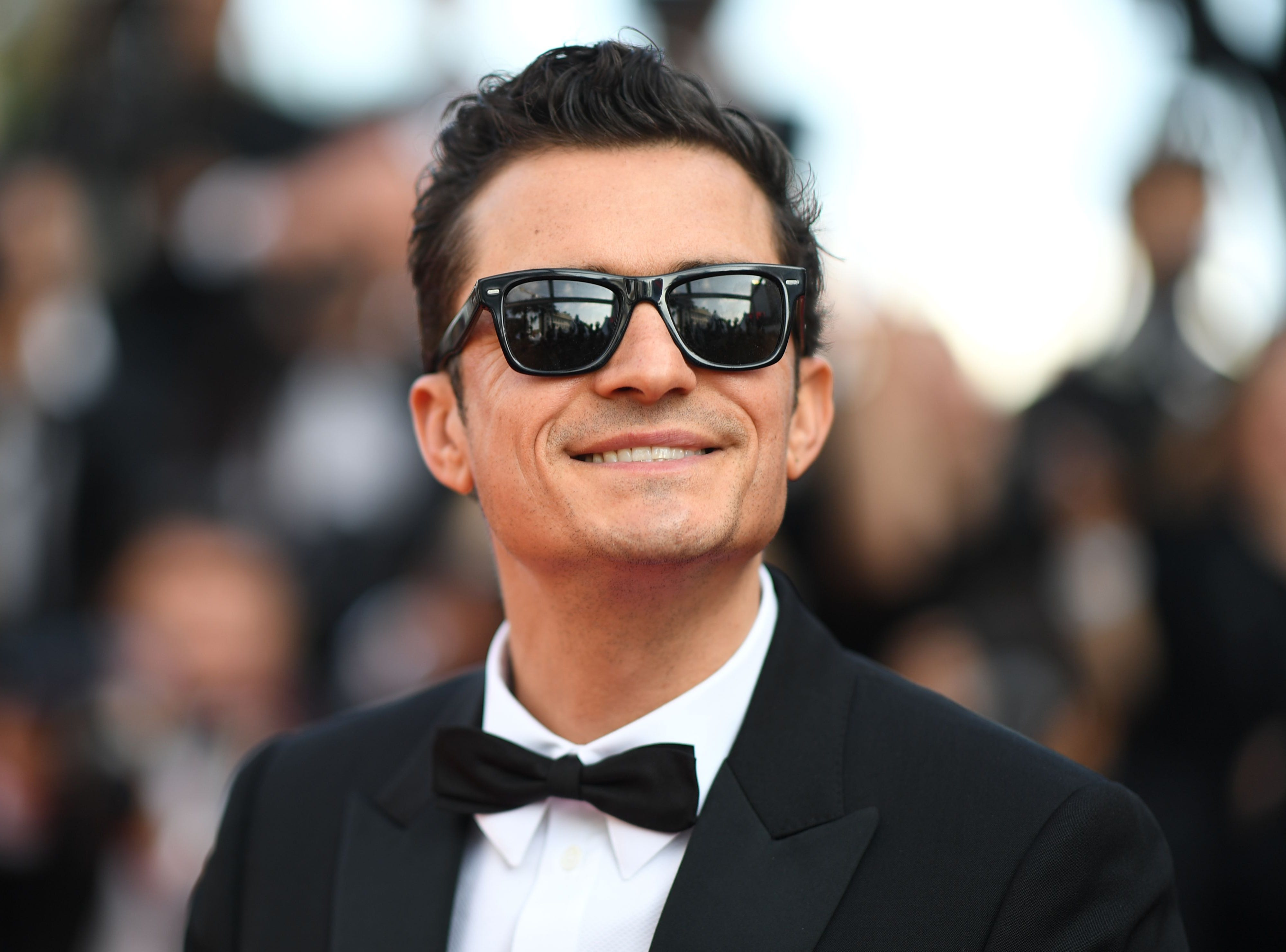 """British actor Orlando Bloom arrives for the screening of the film """"The Traitor (Il Traditore)"""" at the 72nd edition of the Cannes Film Festival in Cannes, southern France, on May 23, 2019."""