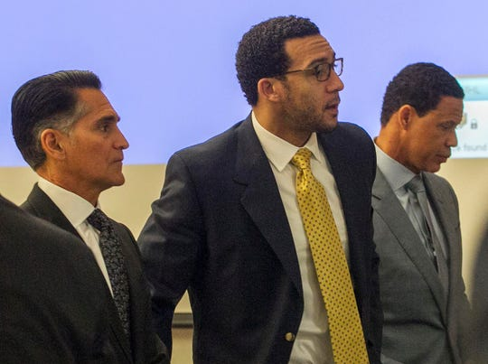 Kellen Winslow is flanked by his attorneys, Brian Watkins (right) and Marc Carlos.