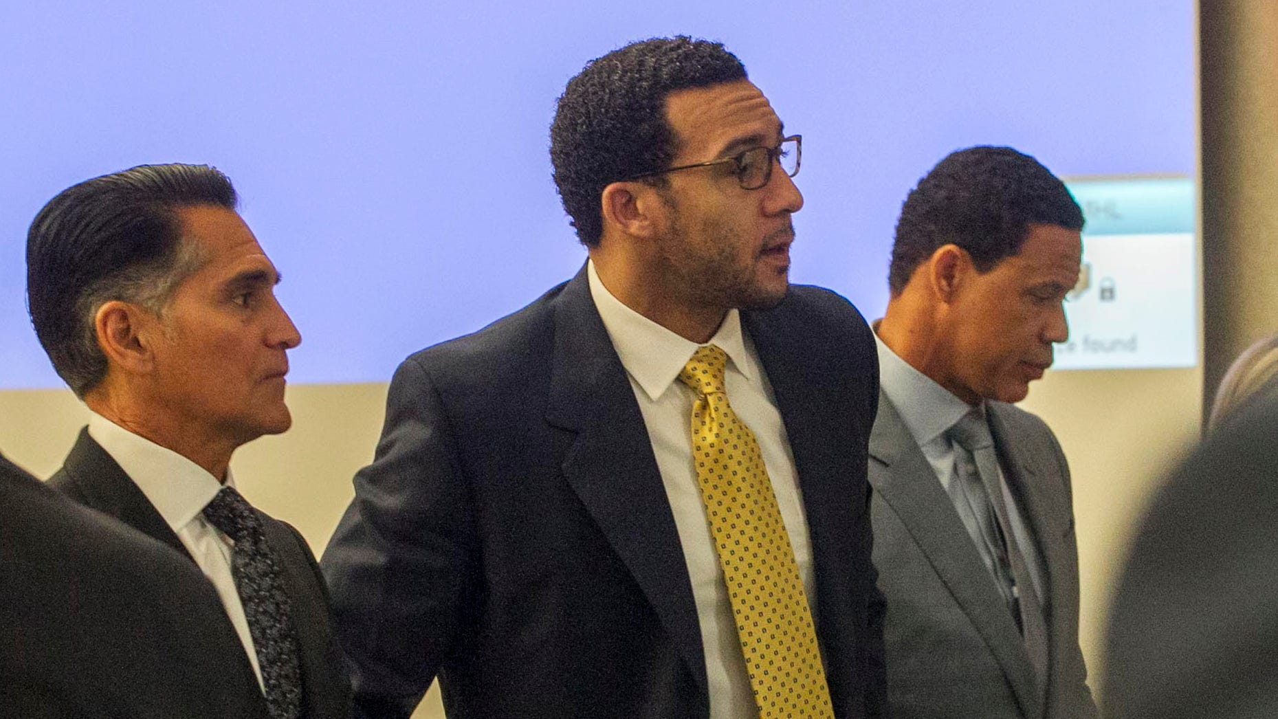 Kellen Winslow is flanked by his attorneys, Brian Watkins (right) and Marc Carlo.