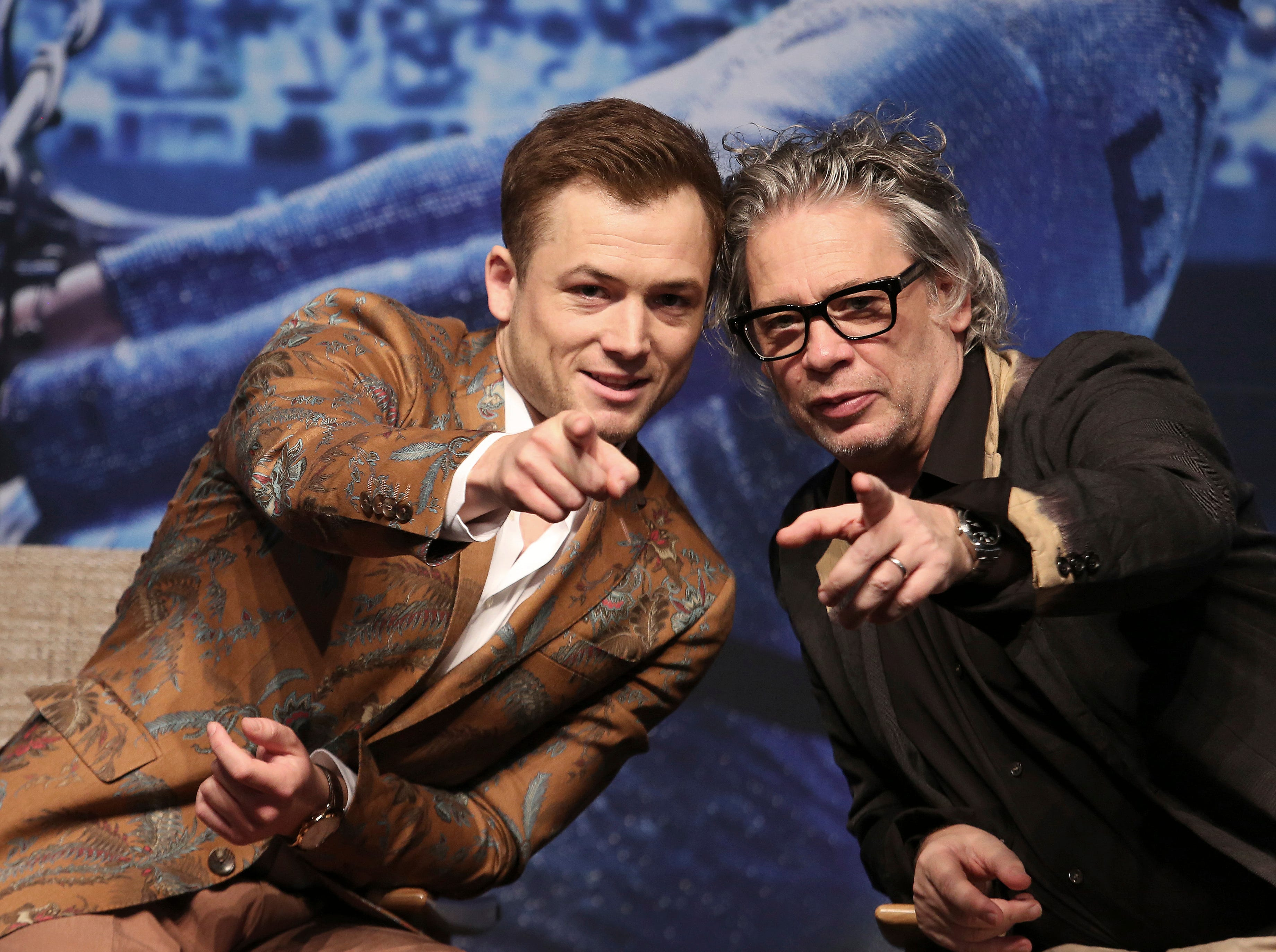"""Actor Taron Egerton, left, and director Dexter Fletcher gesture during a press conference to promote their latest movie """"Rocketman"""" in Seoul, South Korea, Thursday, May 23, 2019."""