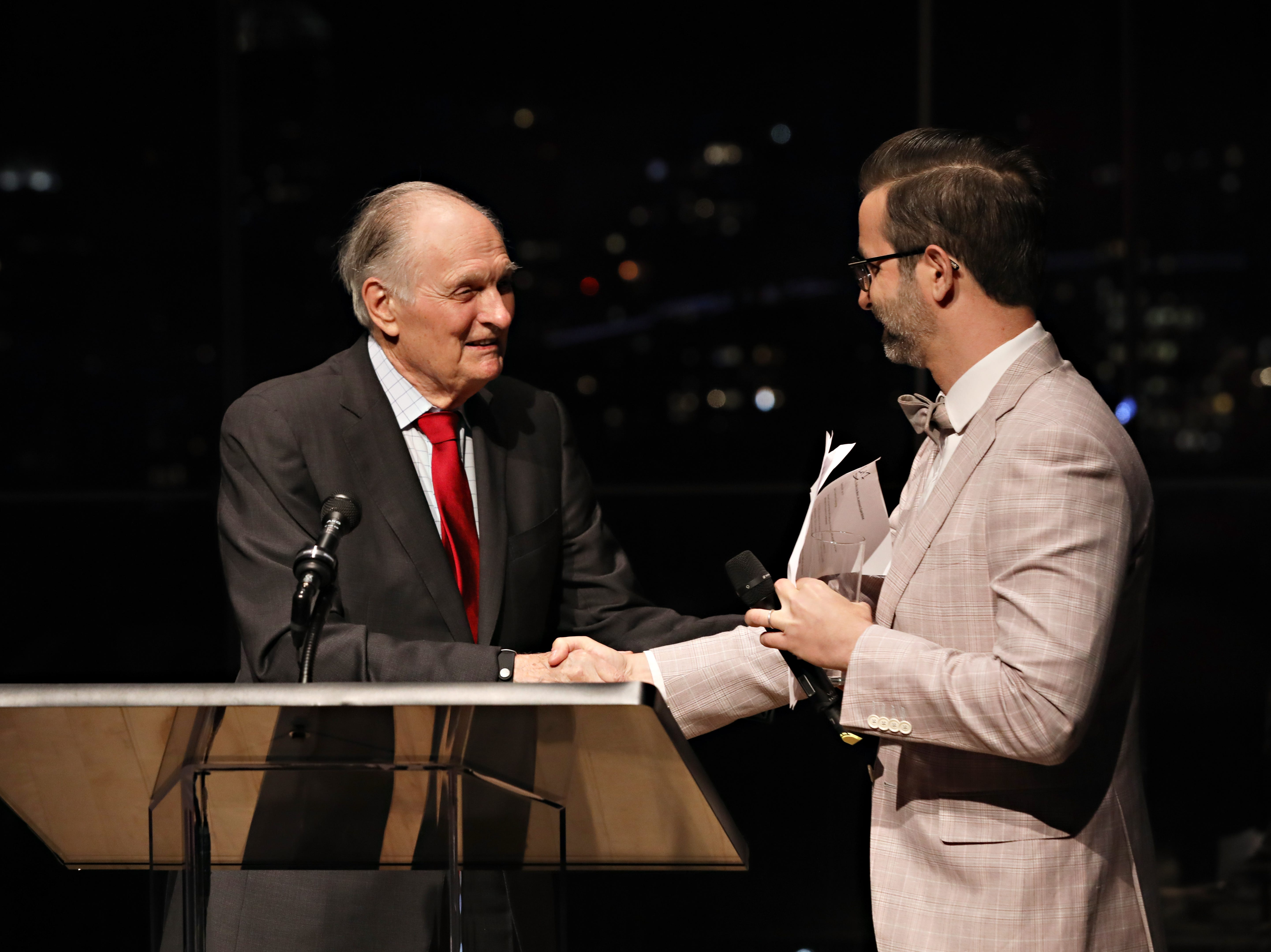 Actor Alan Alda and auctioneer Charles Antin speak during World Science Festival's 12th Annual Gala at Jazz at Lincoln Center on May 22, 2019 in New York City.