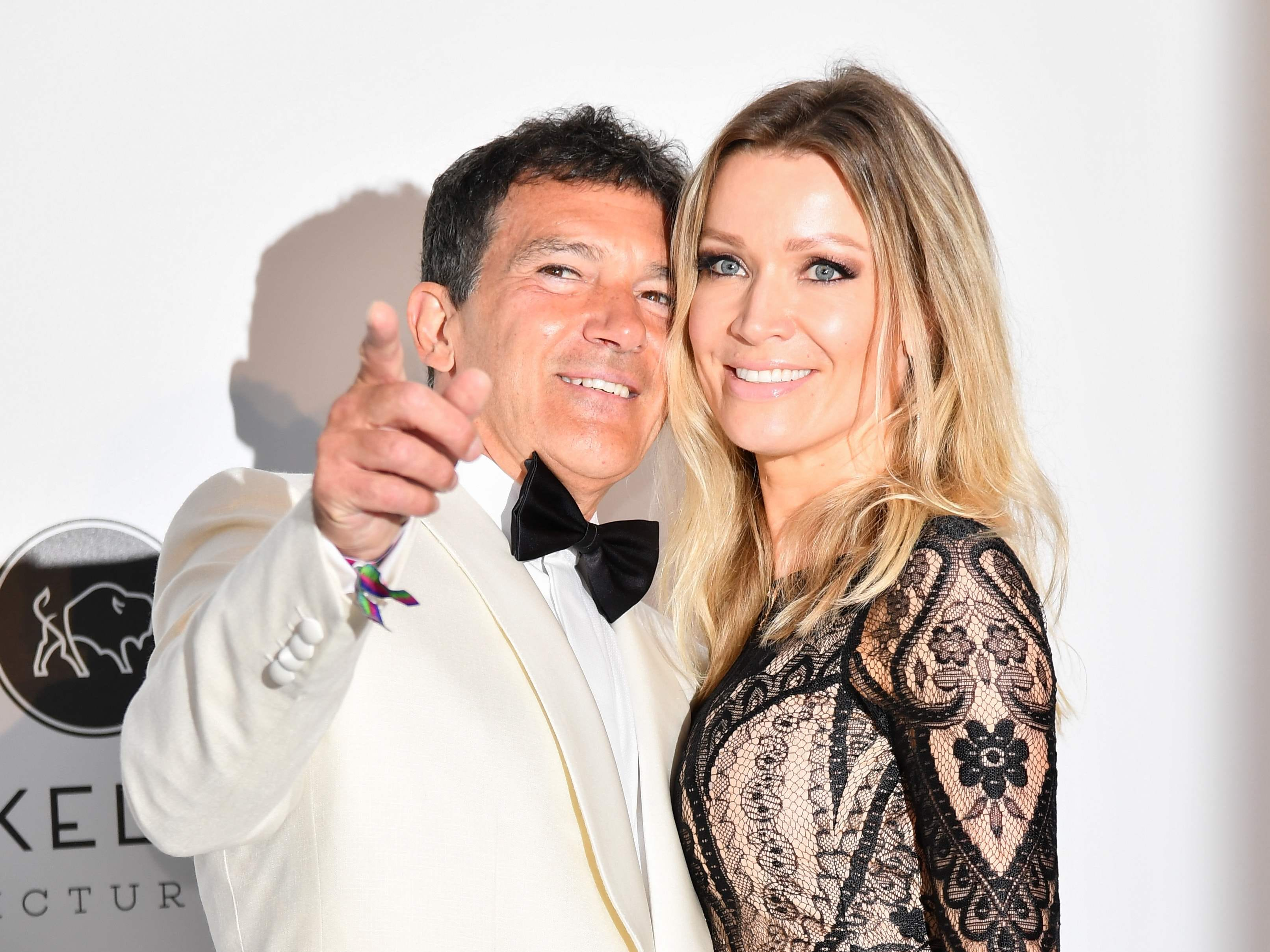 Spanish actor Antonio Banderas and his partner Nicole Kimpel pose as they arrive on May 23, 2019 for the amfAR 26th Annual Cinema Against AIDS gala at the Hotel du Cap-Eden-Roc in Cap d'Antibes, southern France, on the sidelines of the 72nd Cannes Film Festival.