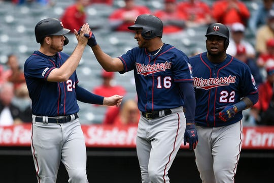 Twins second baseman Jonathan Schoop, center, celebrates his second-inning home run with teammates C.J. Cron, left, and Miguel Sano. The trio combined for five of the Twins' season-high eight homers Thursday against the Angels.