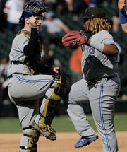 Danny Jansen, left, celebrates with third baseman Vladimir Guerrero Jr. after Toronto's victory over the Chicago White Sox on May 19.